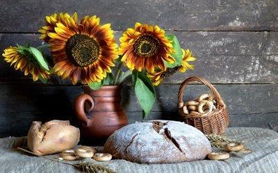 натюрморт, доски, стена, ткань, мешковина, кувшин, цветы, подсолнухи, хлеб, корзина, баранки, колосья